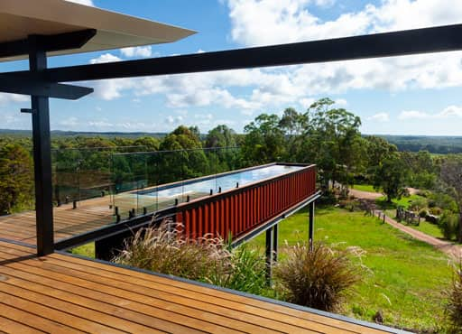 A converted shipping container built on a hill