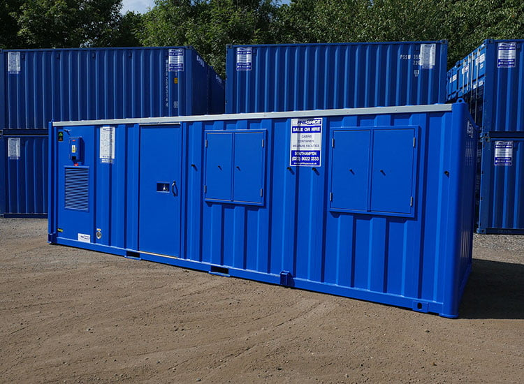 Blue welfare unit with other similar units stacked in the background