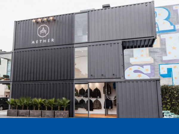 A 3-level shop made of shipping containers
