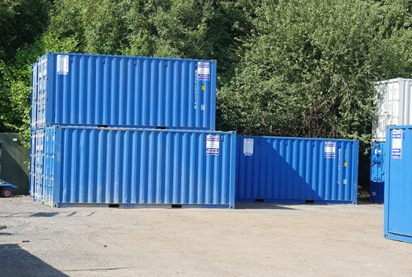 Three storage container boxes with two stacked and one standing alone