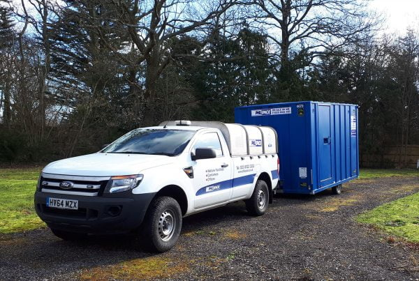 A branded white vehicle towing a branded Philspace welfare unit