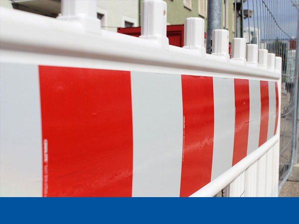 A red and white construction site fence