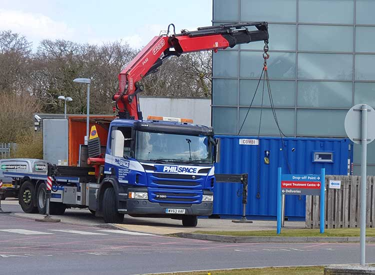 Welfare unit being placed in position